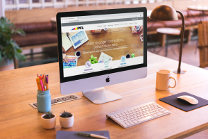 mockup-featuring-an-imac-set-up-on-a-beautiful-wooden-desk-a20415